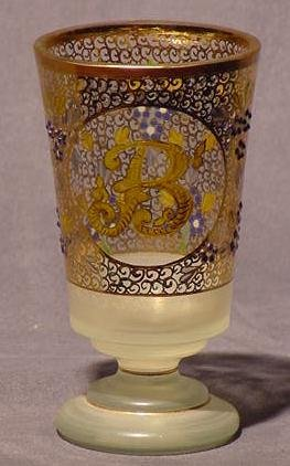 22: CONTINENTAL GILT ENAMELED AND JEWELED GOBLET