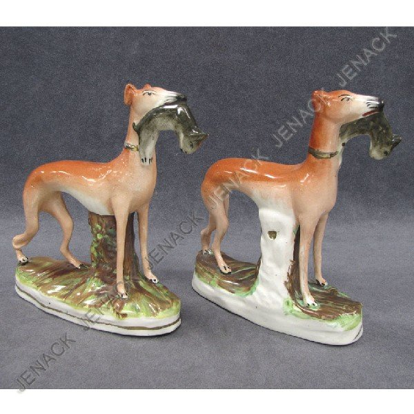 14: PAIR STAFFORDSHIRE POTTERY HUNTING DOGS