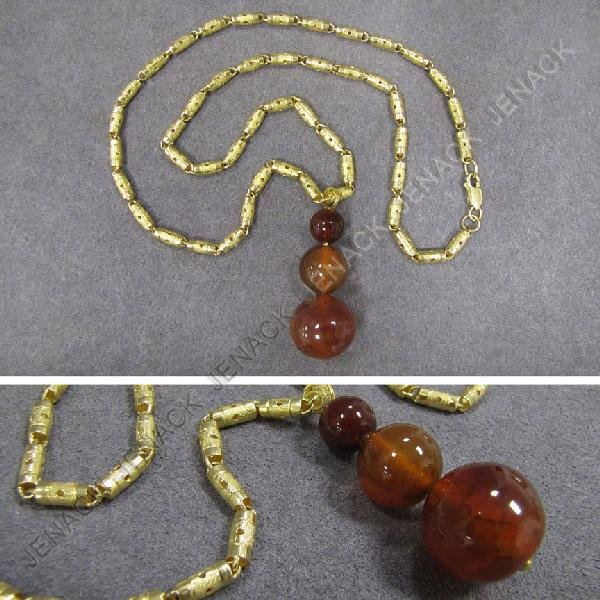 21: CHINESE 14K NECKLACE WITH AMBER BEAD PENDANT