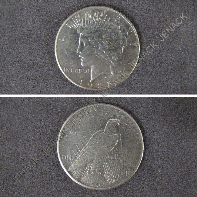 17: 1928 PEACE SILVER DOLLAR COIN (XF40+)