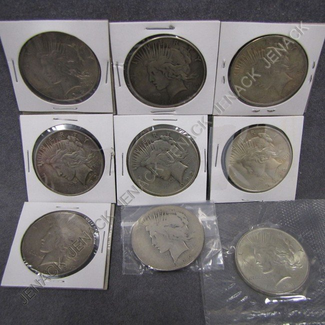 24: LOT (9) ASSORTED US PEACE SILVER DOLLARS