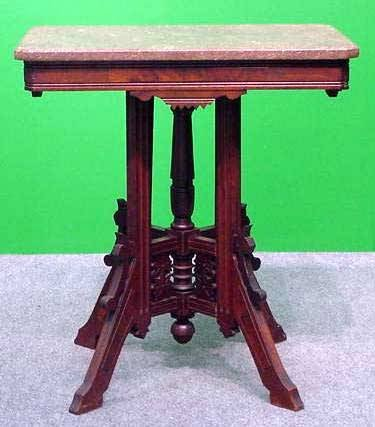 1007: VICTORIAN CARVED WALNUT MARBLE-TOP TABLE