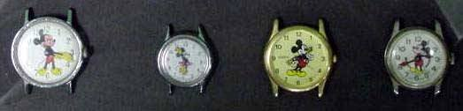 5: LOT (4) ASSORTED FRAMED MICKEY MOUSE WATCHES