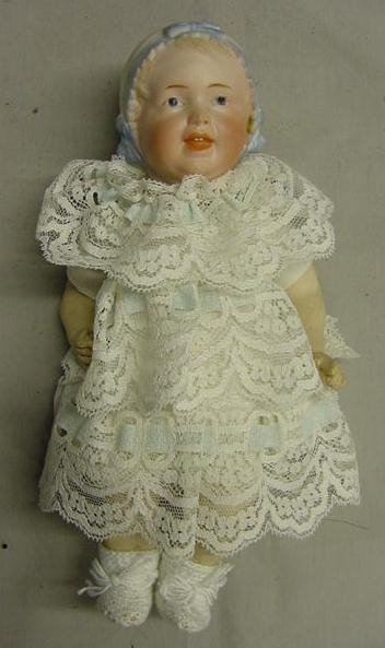 1019: BISQUE SOCKET HEAD DOLL W/JOINTED BODY