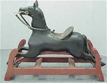 1236: FOLK ART CARVED & PAINTED ROCKING HORSE
