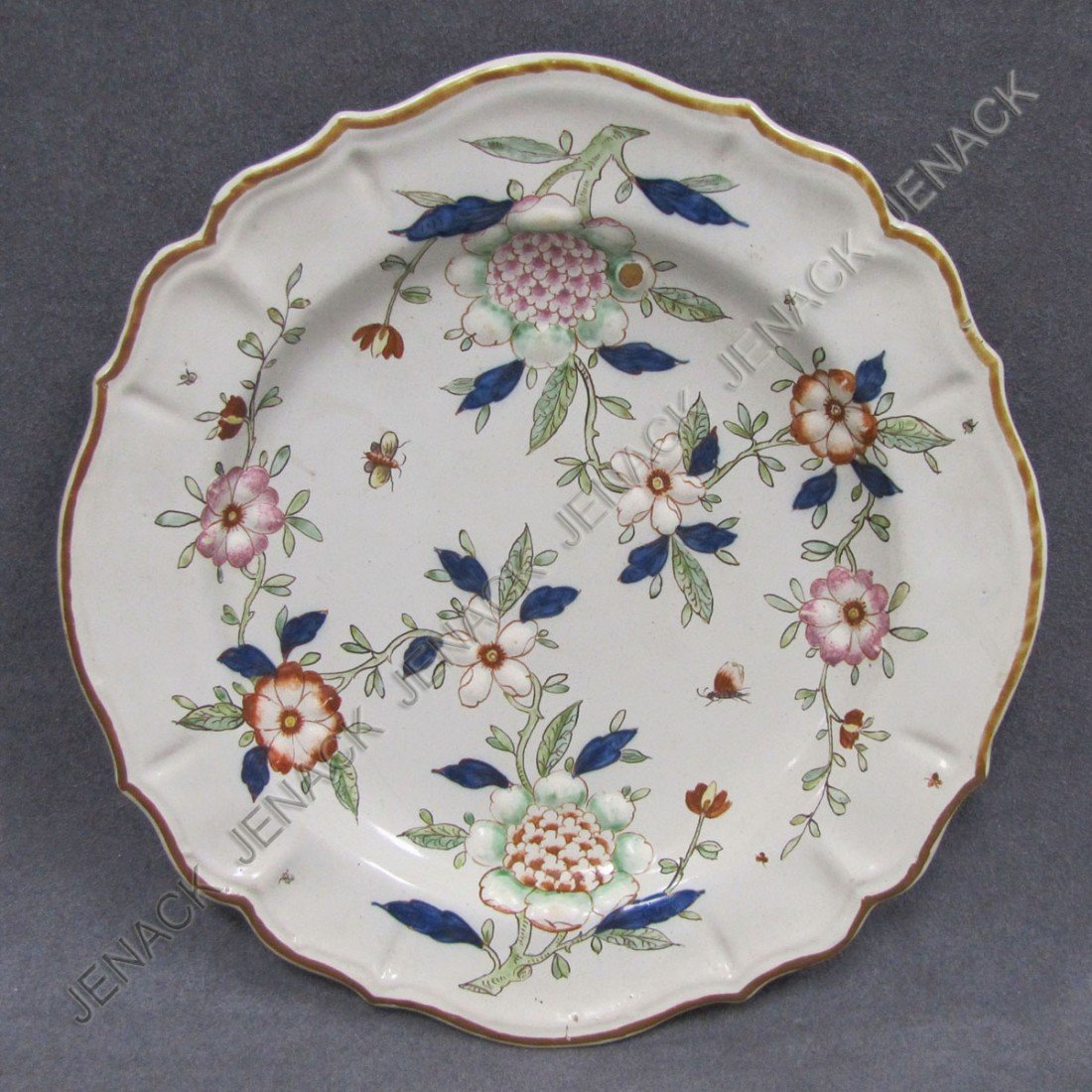 13: FRENCH FAIENCE MOLDED PLATE IN THE CHINESE MANNER