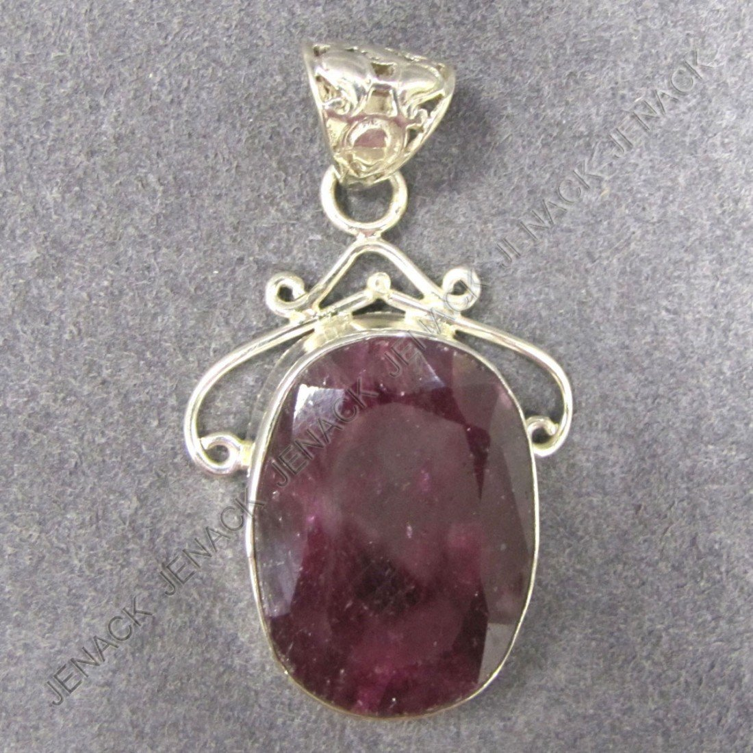 17: 925 STERLING AND 43.66 CT RUBY PENDANT