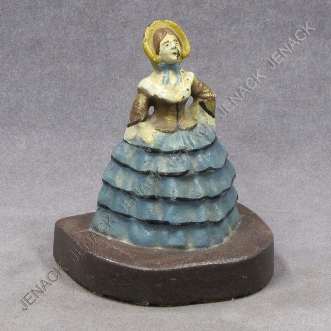 16: CAST IRON COLONIAL LADY WITH BONNET DOORSTOP