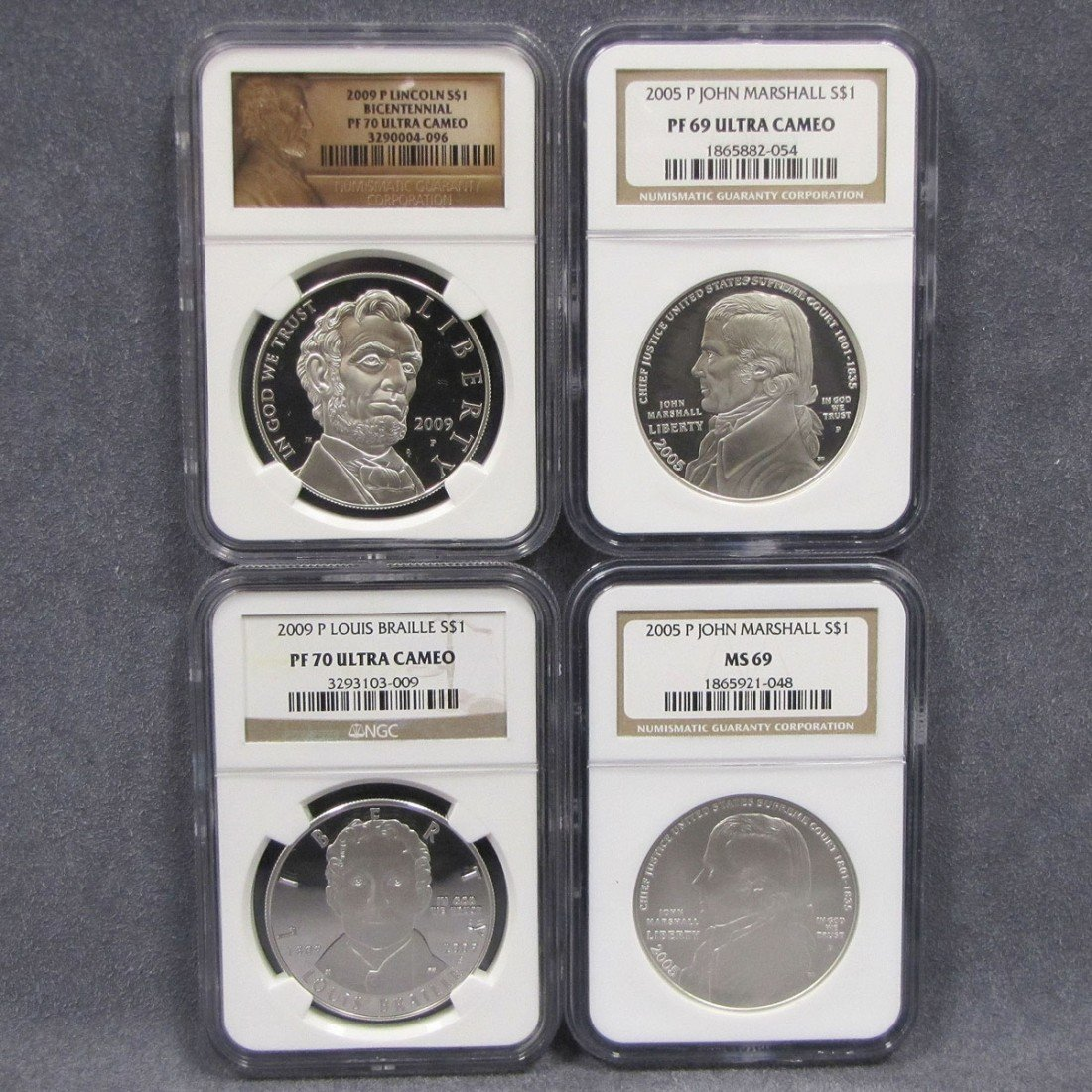 23: LOT (4) ASSORTED COMMEMORATIVE SILVER DOLLAR COINS