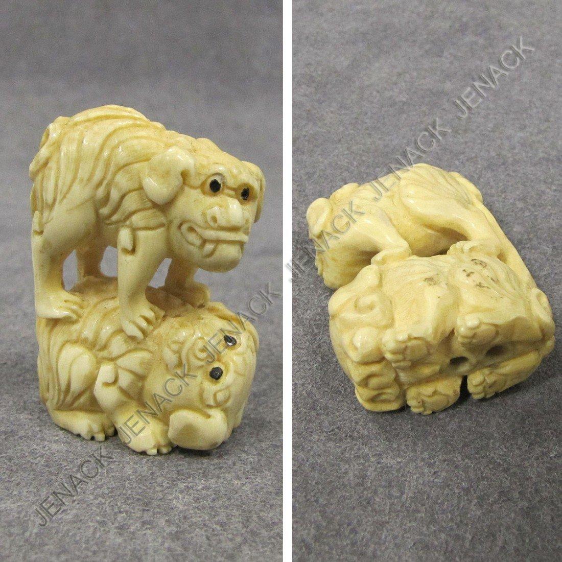 117: JAPANESE CARVED IVORY NETSUKE OF DOGS