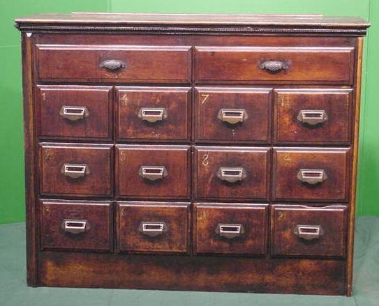 24: APOTHECARY OAK 14-DRAWER CHEST
