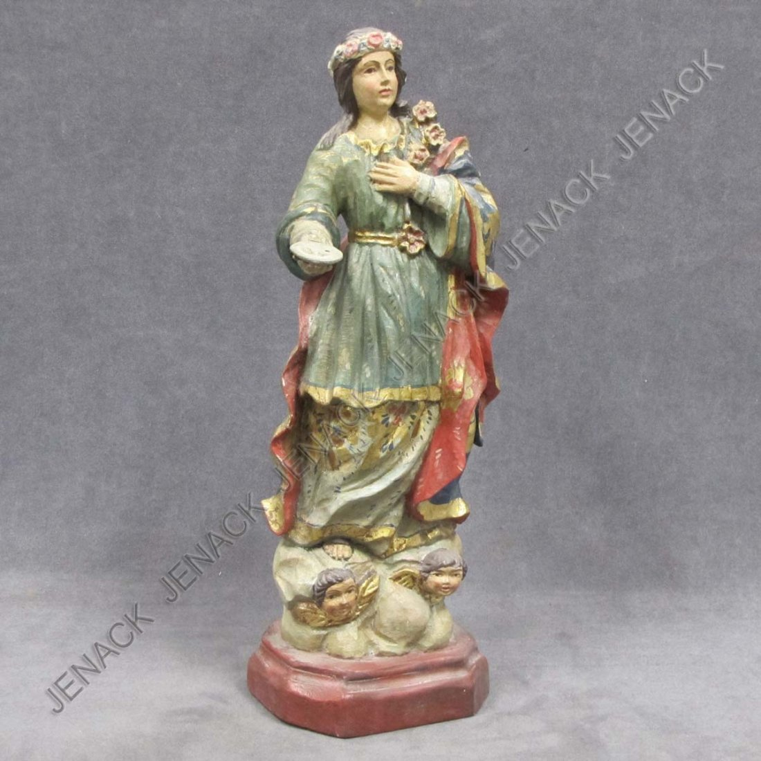 24: SPANISH COLONIAL CARVED AND PAINTED SANTOS FIGURE