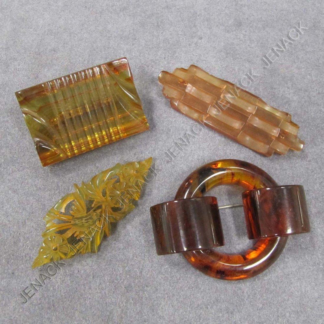 16: LOT (4) VINTAGE TRANSPARENT BAKELITE PINS/BROOCHES