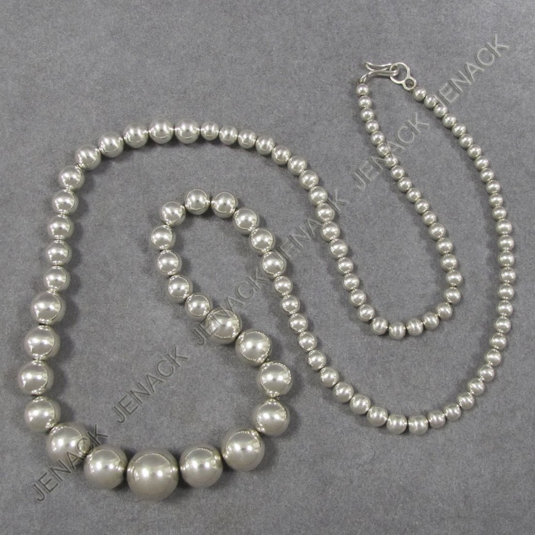 21: GRADUATED STRAND SILVER BEADS