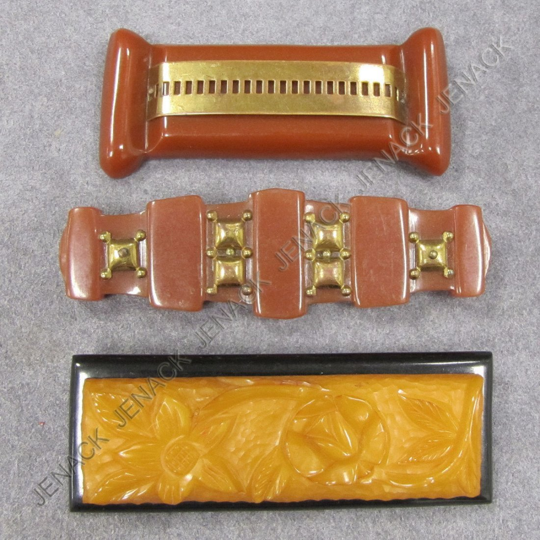 22: LOT (3) VINTAGE CARVED BAKELITE PINS/BROOCHES