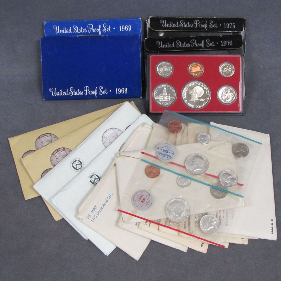 68: LOT INCLUDING (12) ASSORTED MINT SETS 1964-1990