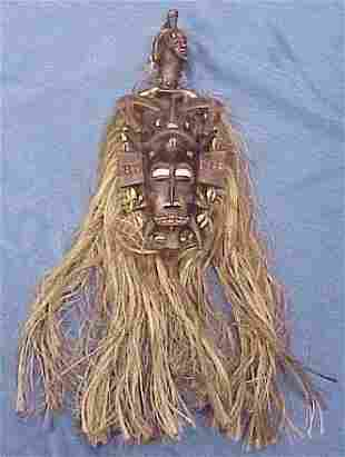 CARVED PAINTED SENUFO MASK WITH RAFFIA