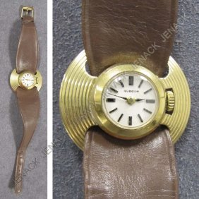 8: .750 GOLD GUBELIN LADY'S 17-JEWEL WRISTWATCH