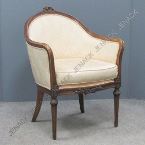 19: FRENCH STYLE CARVED WALNUT ARMCHAIR