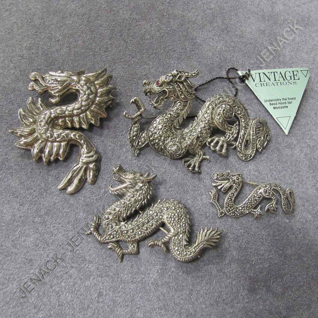 13: LOT (4) STERLING & MARCASITE DRAGON BROOCHES