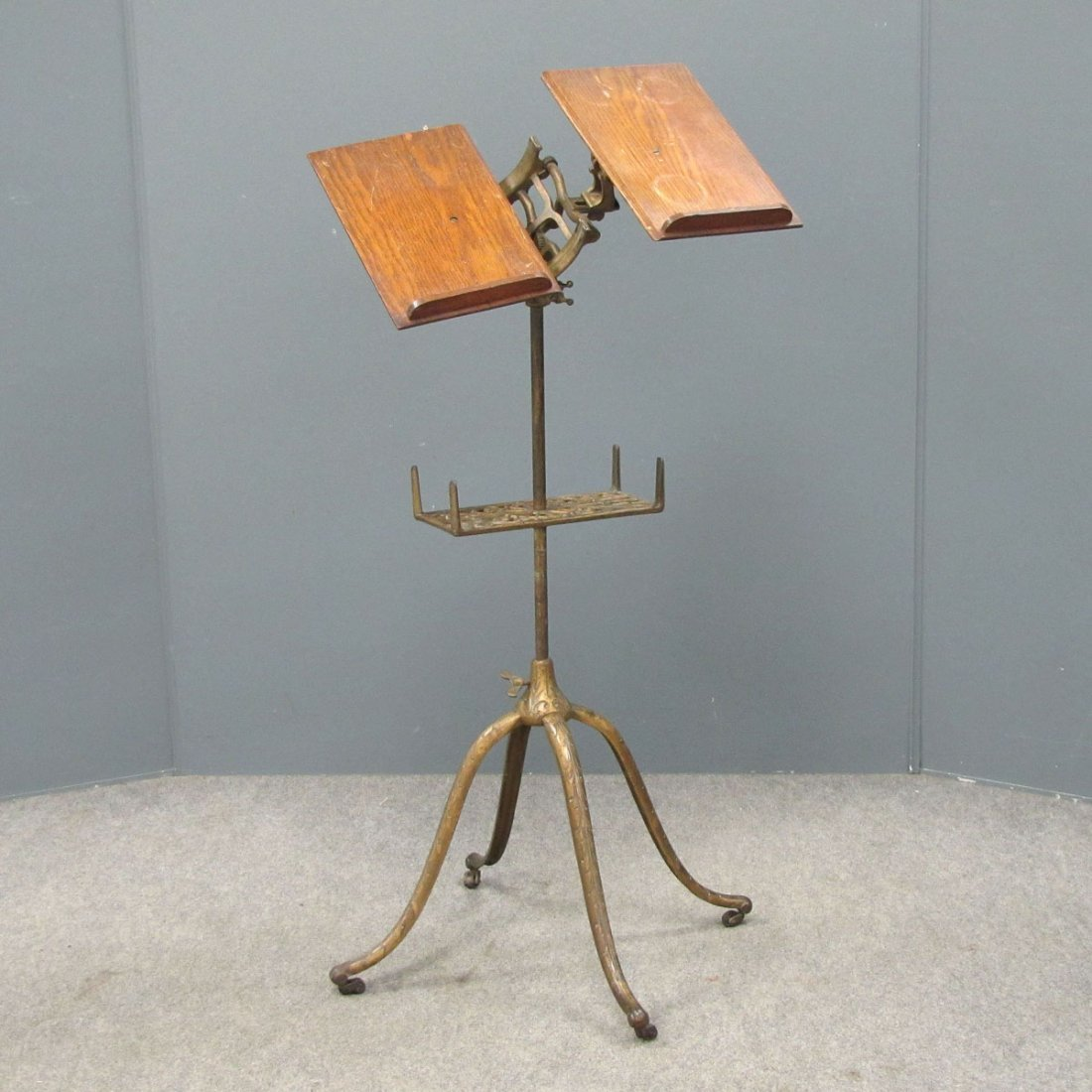 VINTAGE CAST IRON AND OAK ADJUSTABLE BOOK STAND