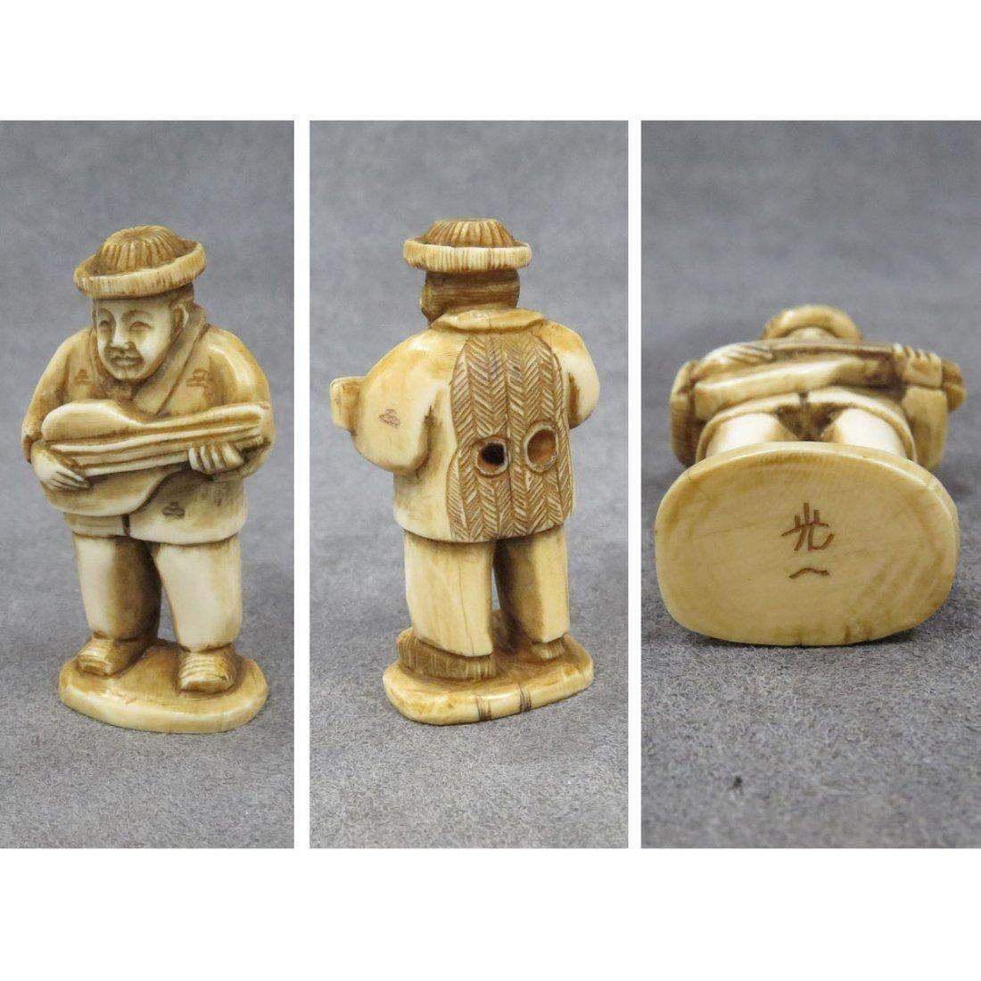 JAPANESE CARVED IVORY NETSUKE, MUSICIAN, SIGNED