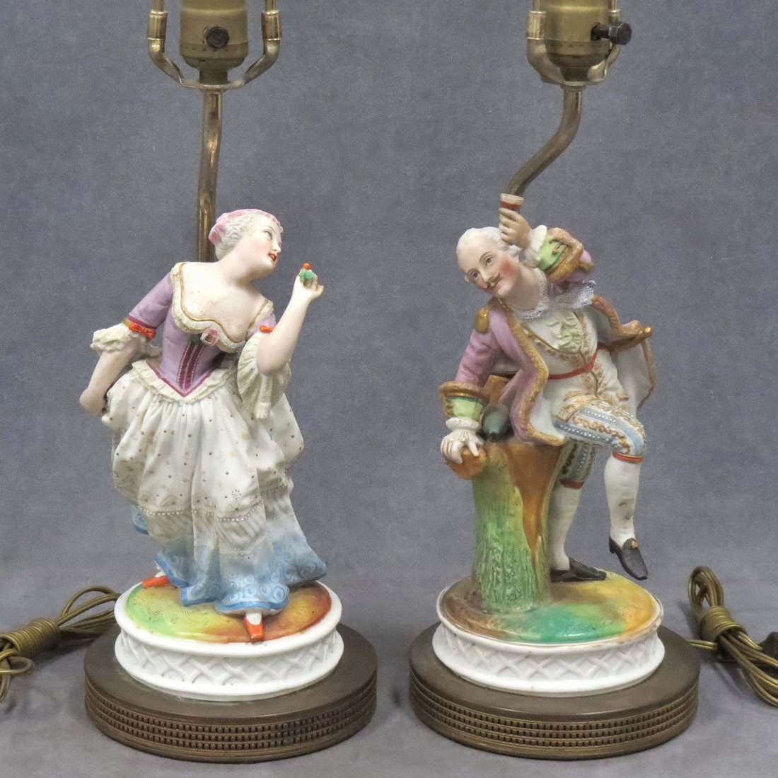 PAIR CONTINENTAL DECORATED PORCELAIN FIGURAL LAMPS