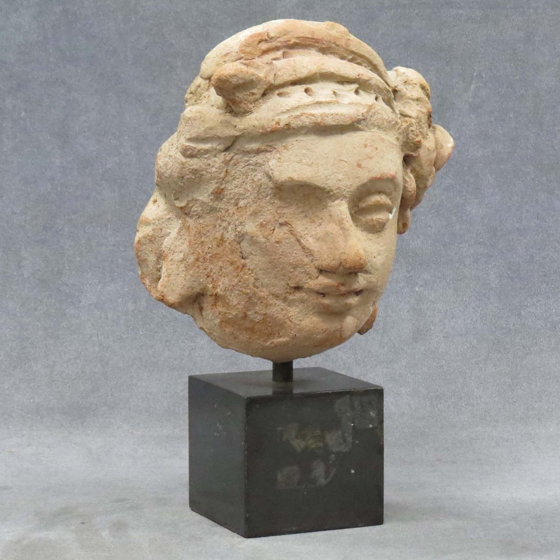 ETRUSCAN CARVED SANDSTONE FEMALE VOTIVE HEAD