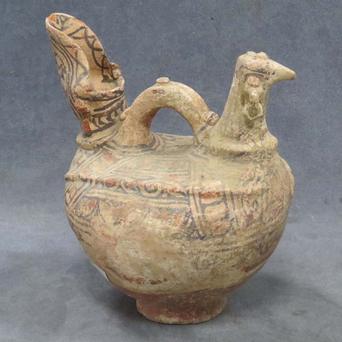 ANCIENT ZOOMORPHIC DECORATED POTTERY VESSEL