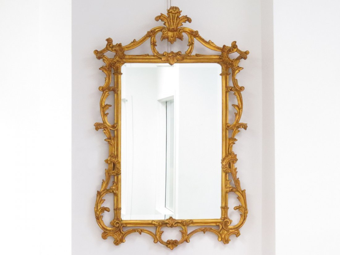 REGENCY STYLE CARVED AND GILT FRAMED MIRROR