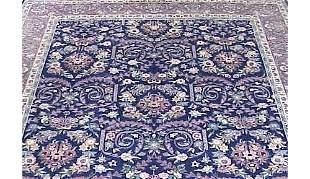SEMI-ANTIQUE KIRMAN BLUE GROUND CARPET