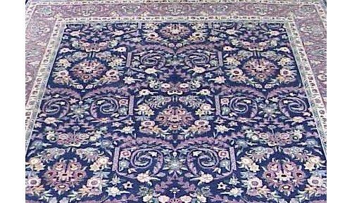 20: SEMI-ANTIQUE KIRMAN BLUE GROUND CARPET