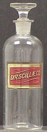 1009: VINTAGE CLEAR GLASS APOTHECARY JAR WITH RED LABEL
