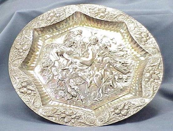24: CLASSICAL SILVER REPOUSSE CHARGER