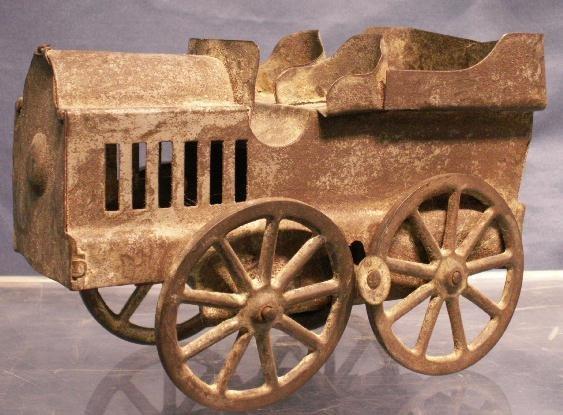 13: VINTAGE CUT METAL TOY CAR