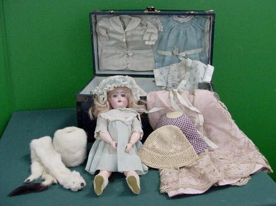 77: GERMAN K*R BISQUE HEAD DOLL WITH CLOTHING/CASE