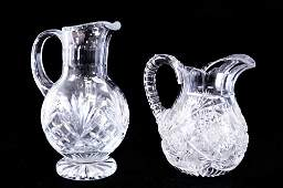 LOT (2) WATERFORD STYLE CUT CRYSTAL PITCHERS. HEIGHT 9
