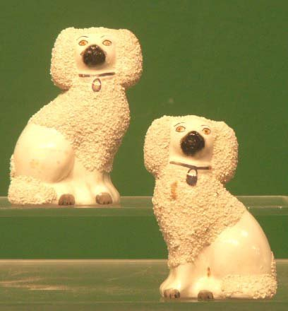 13: PAIR STAFFORDSHIRE POTTERY POODLES