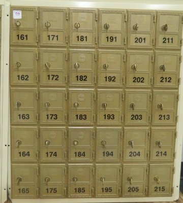 "A SECTION OF 5 X 3 1/2"" POST OFFICE BOXES. HEIGHT 27"";"