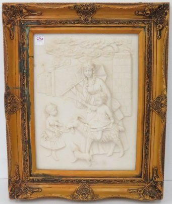 CAST STONE RELIEF PANEL, CHILD ON A GOAT. FRAMED 21 X