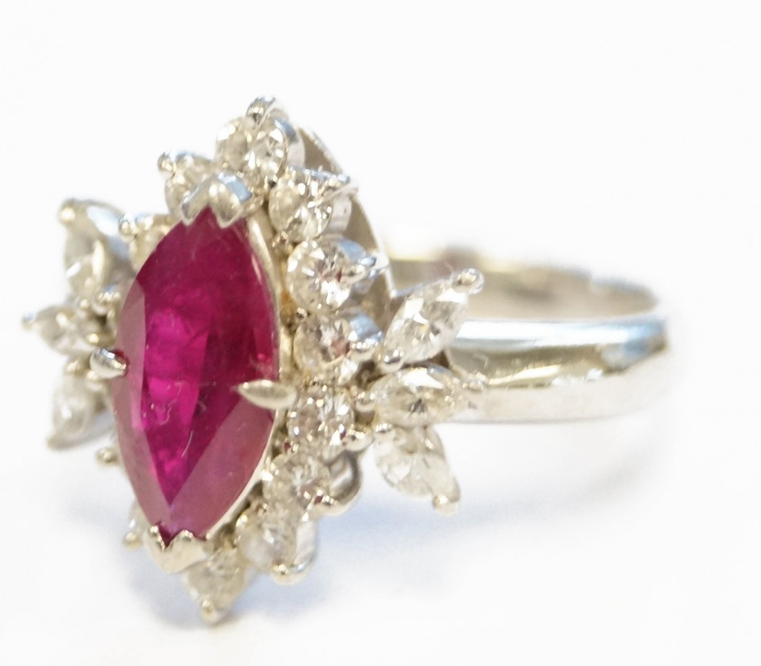 PLATINUM MARQUISE CUT RUBY AND DIAMOND RING, RUBY