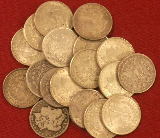 2005: (18) ASSORTED MORGAN SILVER DOLLARS