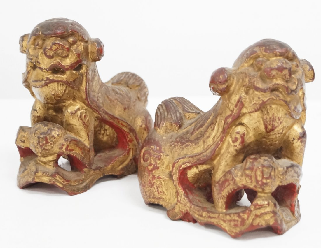 PAIR CHINESE CARVED WOOD PARCEL GILT FOO DOGS, 19/20TH