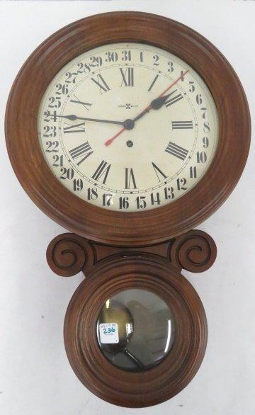 HOWARD MILLER FIGURE 8 REGULATOR WALL CLOCK. HEIGHT 22