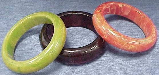 2008: LOT (3) MOLTED BAKELITE BANGLES