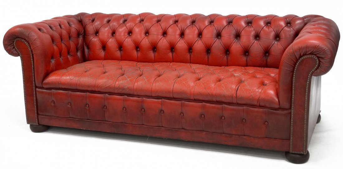 "RED LEATHER CHESTERFIELD SOFA. HEIGHT 30""; WIDTH 84"";"