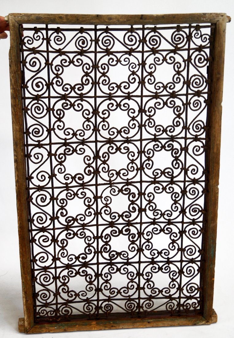 WROUGHT IRON WINDOW GRATE, 19TH CENTURY. 51 X 31""