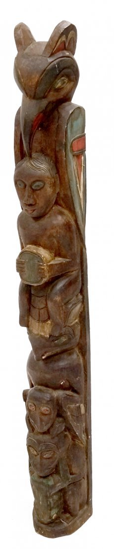 NORTHWEST COAST STYLE CARVED AND PAINTED WOOD TOTEM.