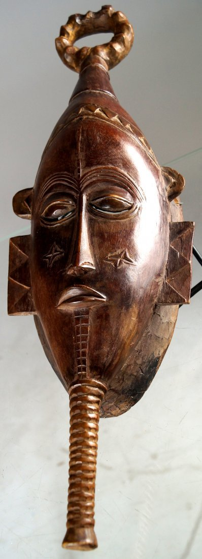 GURO, IVORY COAST, CARVED WOOD ANCESTOR MASK. HEIGHT 18