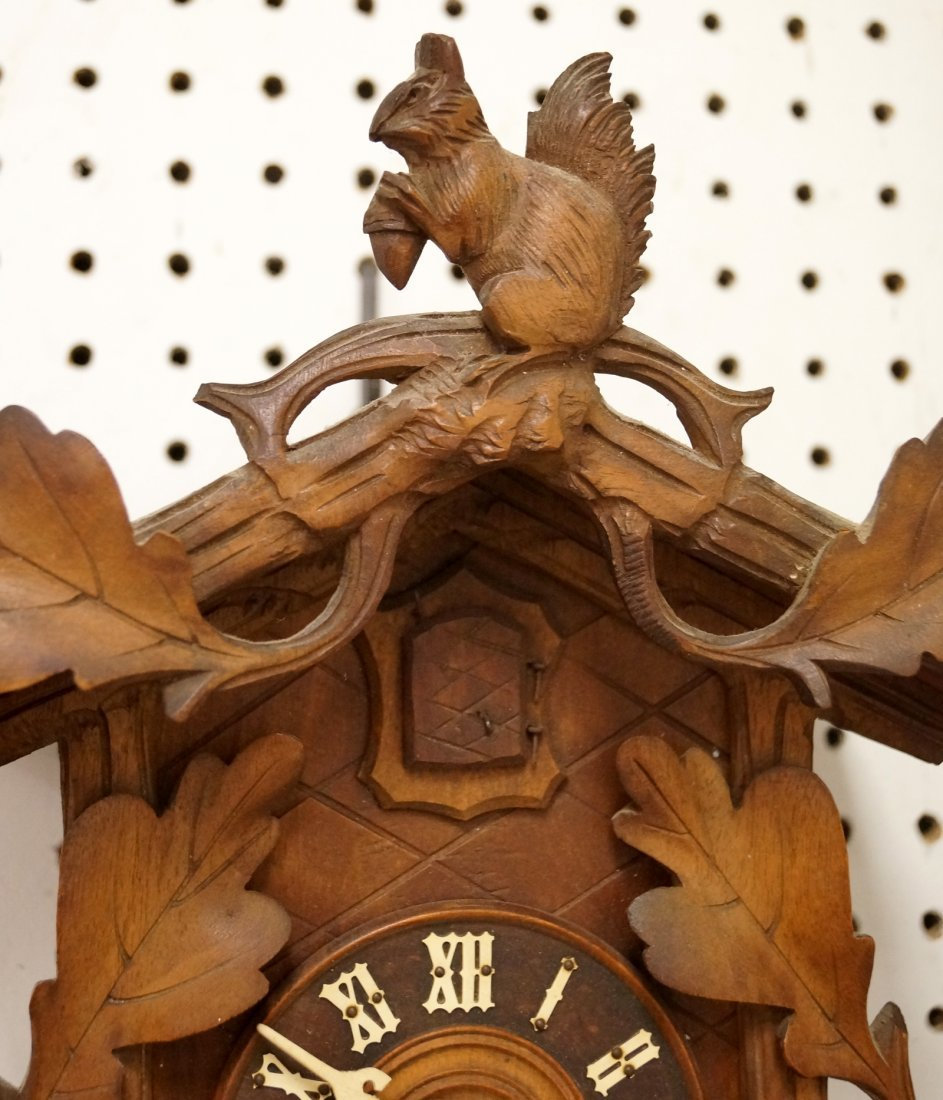 "GERMAN BLACK FOREST CARVED CUCKOO CLOCK. HEIGHT 14"" - 2"